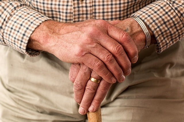 aged-hands-with-walking-stick.jpg
