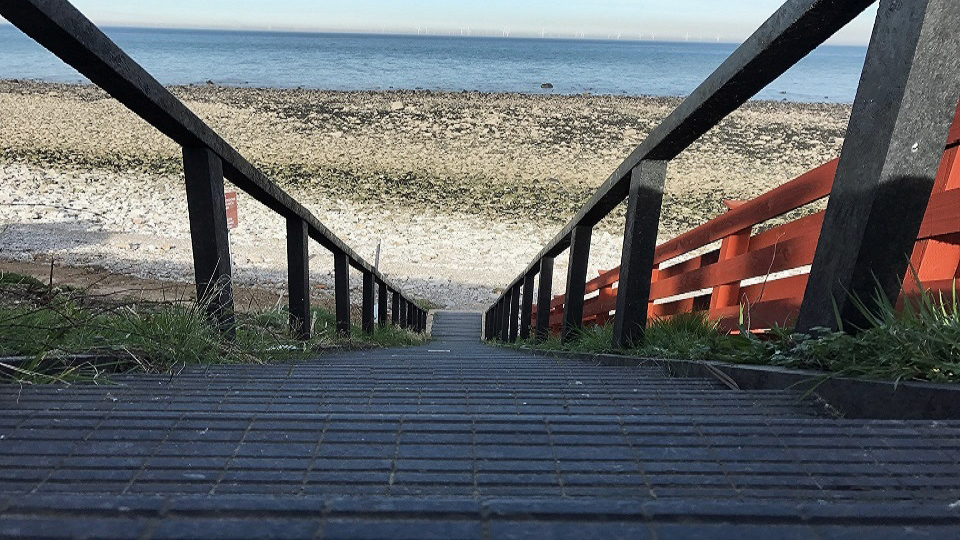 Photograph of a staircase, made with Smartawood, leading down to the beach